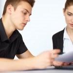 Businesspeople discuss document — Stock Photo