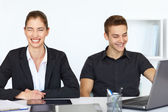 Businesspeople laughing in office — Foto de Stock