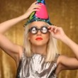 Blonde girl with party hat and silly glasses — Stock Video #17013747