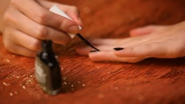 Girl painting her nails black — Stock Video