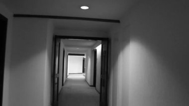 Walking down a hotel corridor — Stock Video