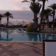 Luxurious hotel pool at sunset — Stock Video