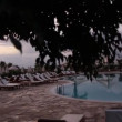 Stock Video: Beautiful hotel pool at sunset