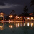 Brightly lit hotel pool at night - Stock Photo