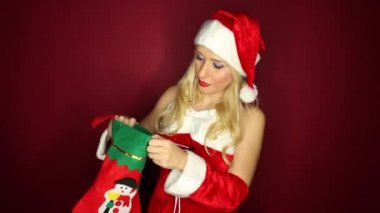 Santa girl is excited about Christmas stocking — Stock Video