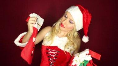 Santa girl throws Christmas stockings — Stock Video