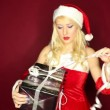Santgirl opens present — Stock Video #17500717