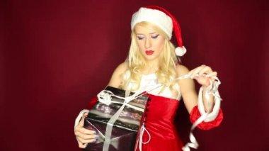 Santa girl opens present — Stock Video