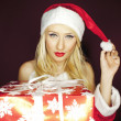 Beautiful blonde Christmas girl with present — Foto de Stock