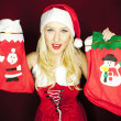 Beautiful Christmas girl with Christmas stockings — Stock Photo