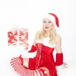 Sexy Christmas girl with present — Stock Photo #17687513