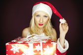 Beautiful blonde Christmas girl with present — Stock Photo