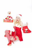 Sexy Christmas girl with Christmas stocking and decoration — Stock Photo