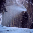 A snow cannon in winter forrest landscape — Vidéo