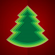 Green paper christmas tree on red background — Stock Photo