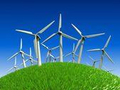 Hermosa pradera verde con las turbinas generadoras de electricidad — Foto de Stock
