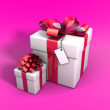 Stock Photo: Gifts on pink background