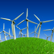 Beautiful green meadow with Wind turbines generating electricity — Stock Photo