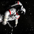 The astronaut on in an outer space against stars — Stock Photo #13308656