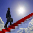 Business man climbs up to the top of 3D success stairs steps — ストック写真