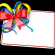 Blank gift tag tied with a bow of red ribbon. — Stock Photo