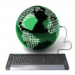 Earth Globe connected with computer keyboard — Stock Photo