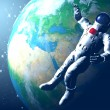 The astronaut on in an outer space against globe — Stock Photo