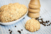 Cheese cookies and black pepper — Stock Photo