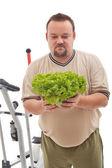 Overweight man not happy about his new diet — Stock Photo