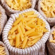 Pasta variety in burlap bags - closeup, top view — Stock Photo