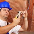 Stock Photo: Worker installing electrical wiring