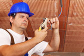 Worker installing electrical wiring — Stock Photo