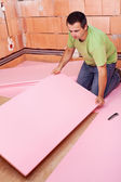 Laying the floor insulation layer in a new house — Stock Photo