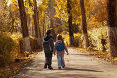 Kids walking in early autumn — Stock Photo