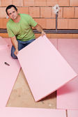 Laying insulation layer in a new house — Stock Photo