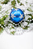Christmas bauble on snowy branch — Stock Photo