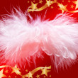 Fluffy christmas angel in golden stars frame — Stock Photo