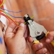 Electrician peeling off wires - Foto de Stock  