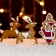 Christmas setting - gingerbread deers and santa — Stock Photo #15324189