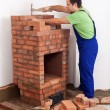 Worker building a brick stove — 图库照片