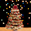 Gingerbread christmas tree with blurry lights - Stock Photo