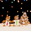 Gingerbread and christmas tree — Stock Photo