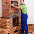 Worker building a masonry heater — Foto Stock