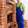 Worker building a masonry heater — Stock Photo