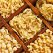 Pasta mix in compartmented wooden box — Stock Photo