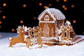 Christmas gingerbread cookie house and deers — Stock Photo