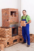 Professional worker building masonry heater — Stock Photo