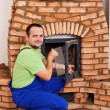 Mason building masonry heater — Stock Photo