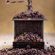 Old grinder with coffee beans - Stock Photo
