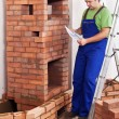Worker building masonry heater — Stock Photo